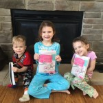 samantha, maddi and holden with grandma's book
